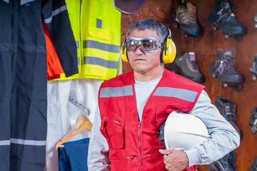 a construction worker wearing protective ear ware